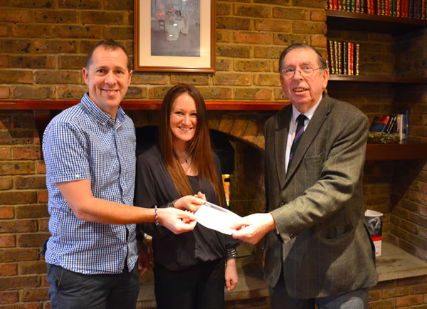 Helping Hands trustees Ian Spencer and Claire Lister receive the £5,000 cheque from WBro Roly Scotney