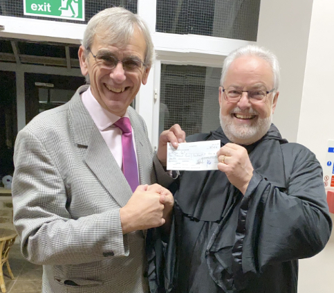 WBro Gerry Crawford presenting the cheque to Ian Richards